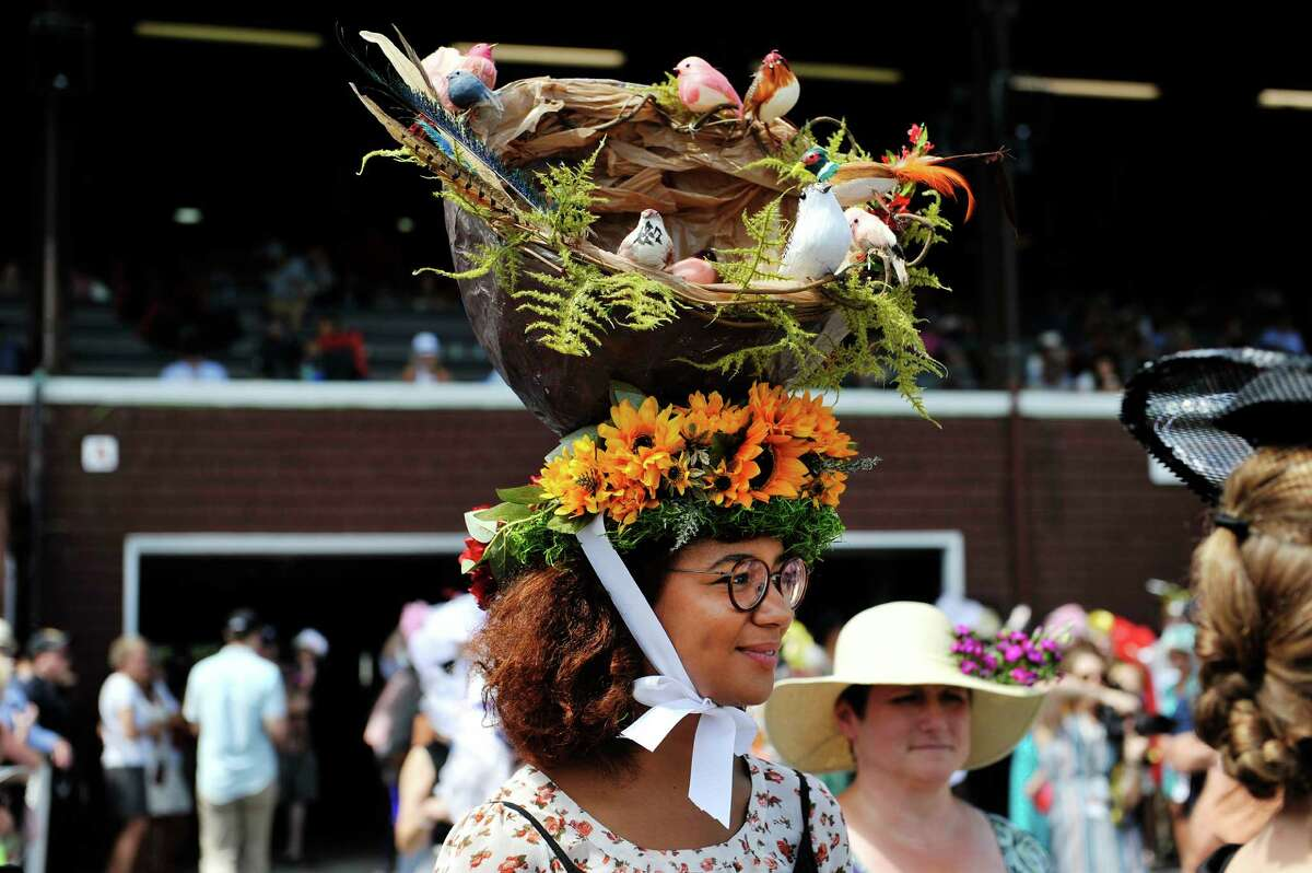Nanette Pengelley of Boston took second place in the Uniquely Saratoga category with her bird's nest hat in the Hats Off to Saratoga hat contest at the Saratoga Race Course on Sunday, July 24, 2016, in Saratoga Springs, N.Y. (Paul Buckowski / Times Union) Downtown Saratoga Springs will no longer host the Hats Off to Saratoga Music Festival, but the popular annual hat contest at the track will continue. Click through the photos to see some of the past years' entries.