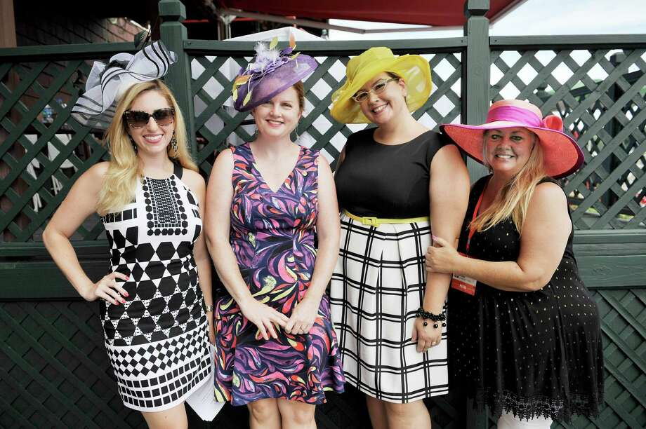Noel McLaren, left, ABC New 10 anchor, who was the MC of the 25th Annual Hats off to Saratoga hat contest, with the judges, from left, Leigh Hornbeck of the Times Union, Bethany Linderman of WGNA and Chris Bushee of Saratoga Today, at the Saratoga Race Course on Sunday, July 24, 2016, in Saratoga Springs, N.Y.   (Paul Buckowski / Times Union) Photo: PAUL BUCKOWSKI / 20037406A