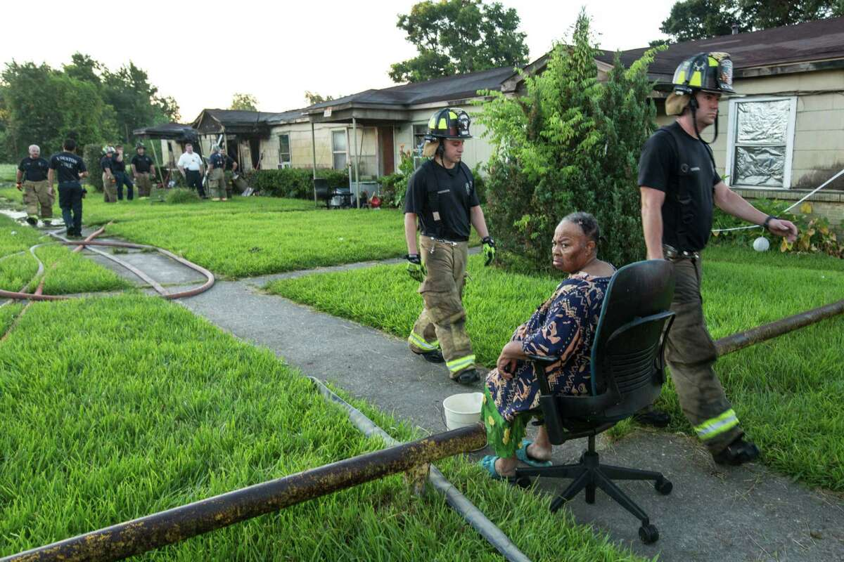 Mabeline Harrison sits outside her home in aftermath of a fire in the 3500 block of Brewster that damaged her home and destroyed two other units on Tuesday, July 19, 2016, in Houston. Residents said everyone living in the complex, made up of four apartments, one of which was empty, got out of the fire safely. Two units were destroyed by fire and the other two suffered smoke damage.