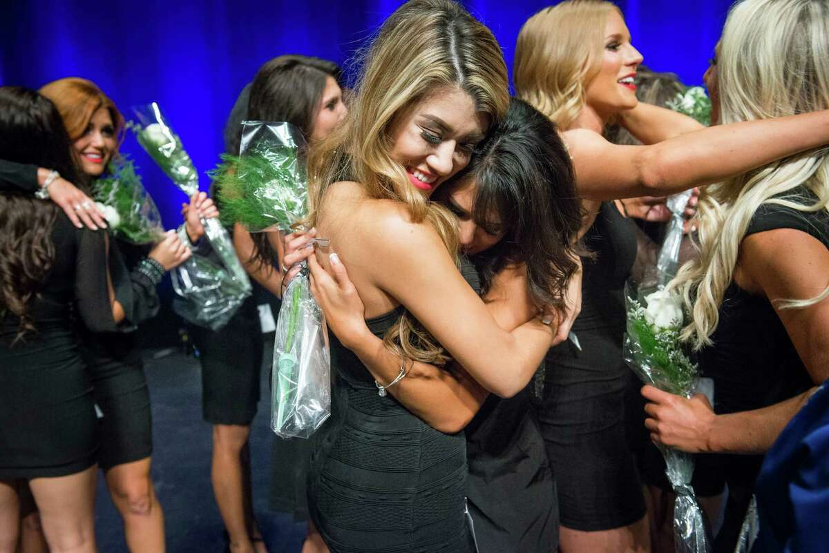 Silver Spurs dancers Lauren, center left, and Brianna, center right, celebrate along with other members of the Silver Spurs dance team after being named to the 16-member group during the final selection night on Sunday, July 24, 2016.