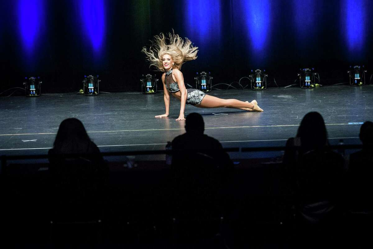 Silver Spur dancing hopeful Brittany performs onstage before the judges during the final selection night of the Silver Spurs dance team where 16 members were selected on Sunday, July 24, 2016.