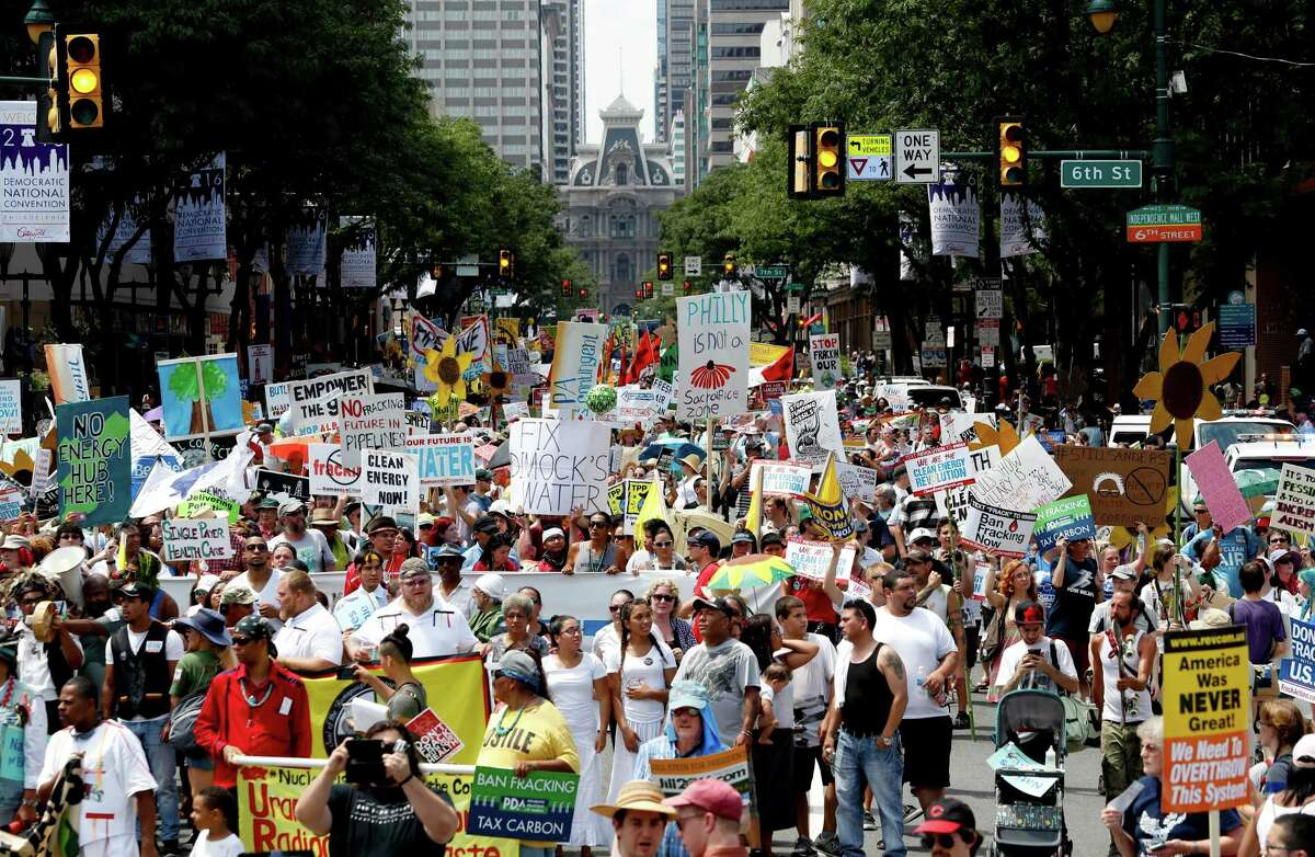 Protesters march Sunday in downtown Philadelphia ahead of the Democratic National Convention.