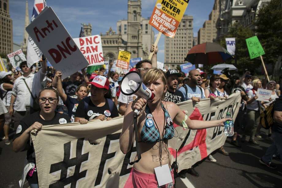 "Protesters demonstrate at the ""March For Bernie"" ahead of the Democratic National Convention (DNC) in Philadelphia, U.S., on Sunday, July 24, 2016. A heat wave has settled over the City of Brotherly Love as tens of thousands of delegates converge on the city for the Democratic National Convention. Photographer: Victor J. Blue/Bloomberg Photo: Victor J. Blue, Bloomberg"