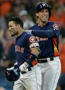 Jose Altuve receives a warm greeting from George Springer after hitting a two-run homer in the second inning Sunday.