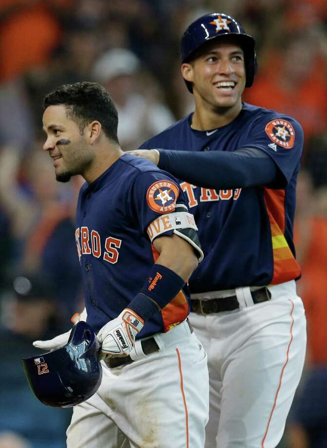 Jose Altuve receives a warm greeting from George Springer after hitting a two-run homer in the second inning Sunday. Photo: Melissa Phillip, Staff / © 2016 Houston Chronicle
