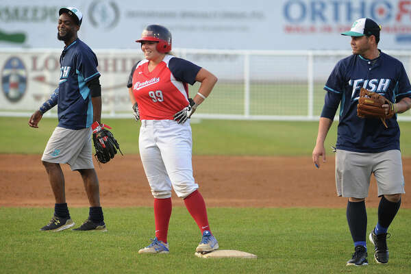 Hannah Cooper of the Stratford Brakettes stands on second base next to Sam Gervacio of the Bridgeport Bluefish during the annual game between the two teams Sunday at the Ballpark at Harbor Yard in Bridgeport.
