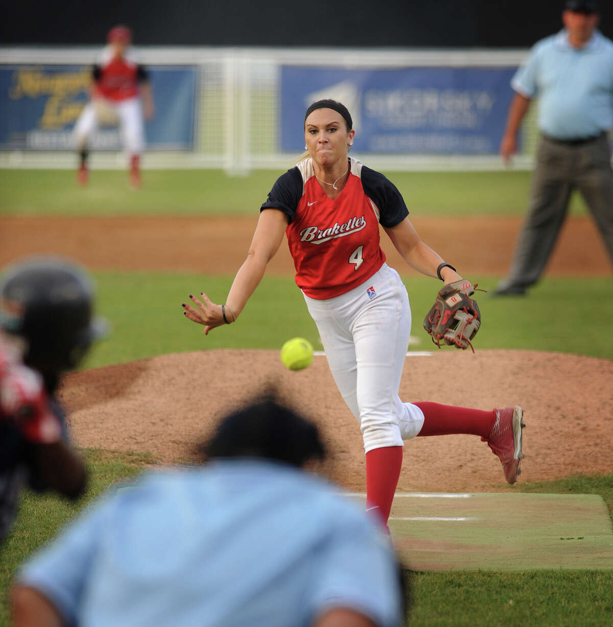 Stratford Brakettes pitcher Tatum Buckley delivers to the plate during her team's annual game against the Bridgeport Bluefish Sunday at the Ballpark at Harbor Yard in Bridgeport.
