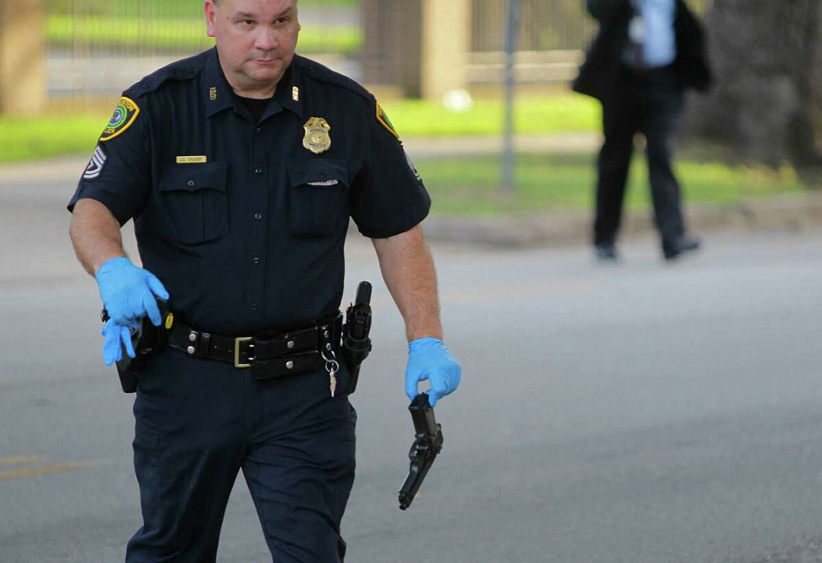 A police officer carries a pellet gun at the site of an officer-involved shooting Sunday, July 24, 2016. The man who was shot was taken to Ben Taub General Hospital.