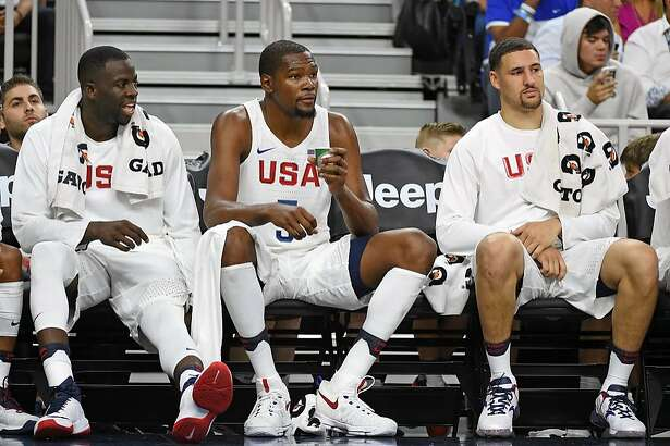 LAS VEGAS, NV - JULY 22:  (L-R) Draymond Green #14, Kevin Durant #5 and Klay Thompson #11 of the United States sit on the bench during a USA Basketball showcase exhibition game against Argentina at T-Mobile Arena on July 22, 2016 in Las Vegas, Nevada. The United States won 111-74.  (Photo by Ethan Miller/Getty Images)