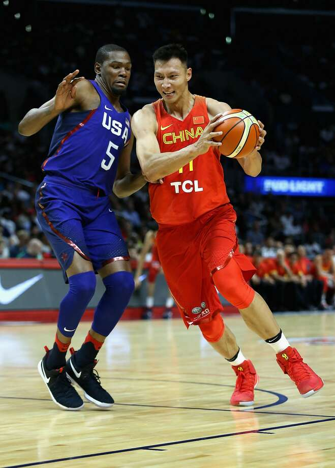 LOS ANGELES, CA - JULY 24:  Yi Jianlian #11  of China drives to the basket against Kevin Durant #5 of the United states during the first half of a USA Basketball showcase exhibition gameat Staples Center on July 24, 2016 in Los Angeles, California.  (Photo by Sean M. Haffey/Getty Images) Photo: Sean M. Haffey