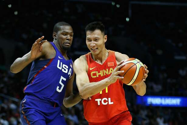 LOS ANGELES, CA - JULY 24:  Yi Jianlian #11  of China drives to the basket against Kevin Durant #5 of the United states during the first half of a USA Basketball showcase exhibition gameat Staples Center on July 24, 2016 in Los Angeles, California.  (Photo by Sean M. Haffey/Getty Images)