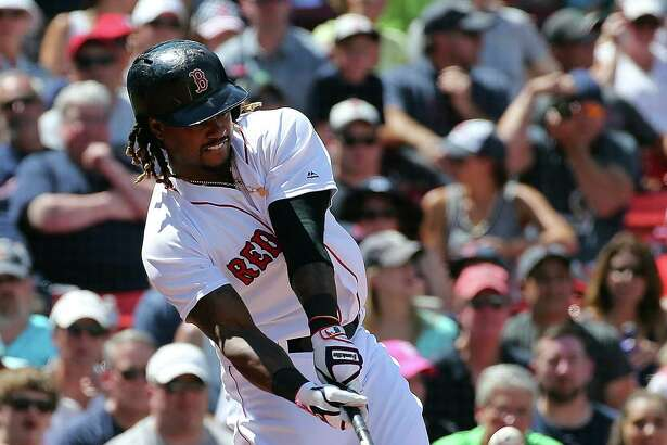 BOSTON, MA - JULY 24:  Hanley Ramirez #13 of the Boston Red Sox hits a three-run home run in the third inning against the Minnesota Twins at Fenway Park on July 24, 2016 in Boston, Massachusetts. (Photo by Jim Rogash/Getty Images) ORG XMIT: 607682285