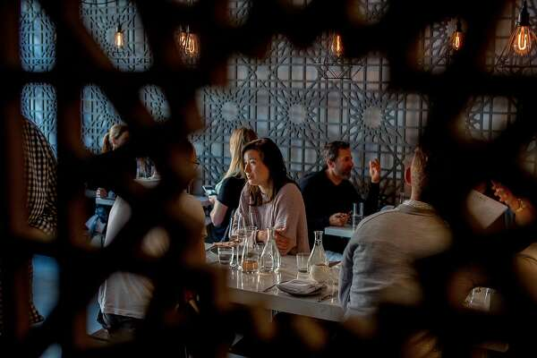 People have dinner at Tawla in San Francisco, Calif. on July 24th, 2016.