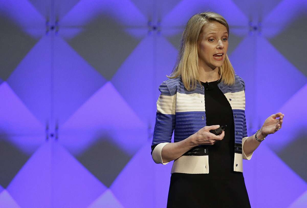 FILE - In this Feb. 18, 2016, file photo, Yahoo CEO Marissa Mayer delivers the keynote address at the Yahoo Mobile Developer Conference in San Francisco. Yahoo reported Tuesday, April 19, 2016, that after subtracting ad commissions, Yahoo's revenue fell 18 percent from the same time a year earlier, to $859 million. It's the largest decline in Yahoo's quarterly net revenue since the company hired Mayer as its CEO nearly four years ago. (AP Photo/Eric Risberg, File)