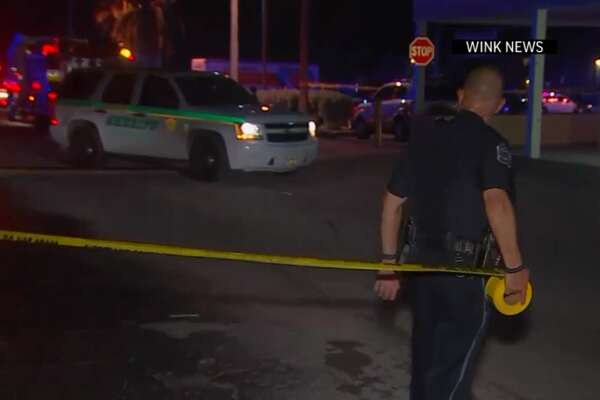 In this frame from video, people gather near the scene of a fatal shooting at Club Blu nightclub in Fort Myers, Fla., Monday, July 25, 2016.