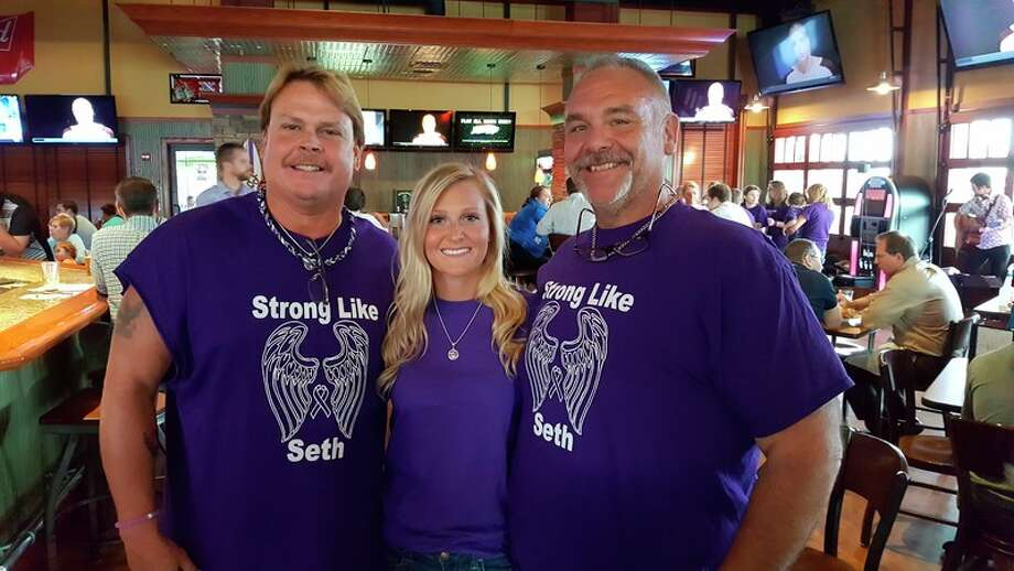 Mark Enszer, Autumn Enszer and Bob David wear their Strong Like Seth shirts recently at a fundraiser at Big E's restaurant in Midland to raise money for the Epilepsy Foundation of Michigan and remember Seth Enszer, who died in April from epilepsy.