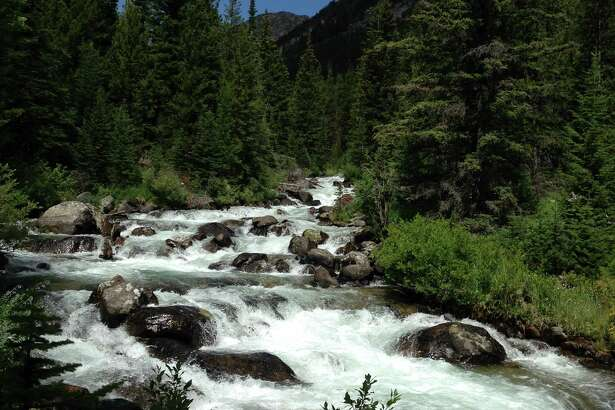Photo credit/STEVE GRIFFIN Rock Creek tumbles over the elements for which it is named.