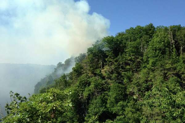 On Saturday morning, July 23, the state Department of Energy and Environmental Protection closed  Lovers Leap Park after a fire from the night before flared up again.