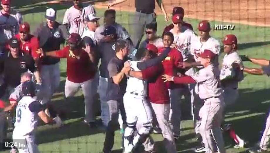 The Corpus Christi Hooks and the Frisco Roughriders - the Class AA teams for the Houston Astros and Texas Rangers - got into a benches-clearing brawl Sunday at Whataburger Field in Corpus Christi. Photo: Ian Steele/KIII-TV