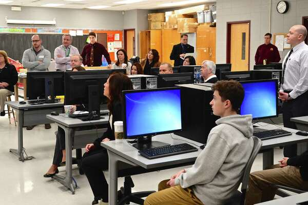 Bethel Public Schools, faculty and members of the Business Advisory Council, a partnership between the district and representatives from local businesses and colleges, watch a student's presentation at the new STEM lab at Bethel High School on Friday, Jan. 29, 2016.