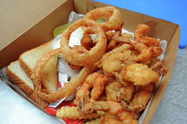 The fried shrimp basket at Monceaux's in Groves consists of shrimp, onion rings, fries and toast.   Photo taken Wednesday, April 28, 2016 Guiseppe Barranco/The Enterprise