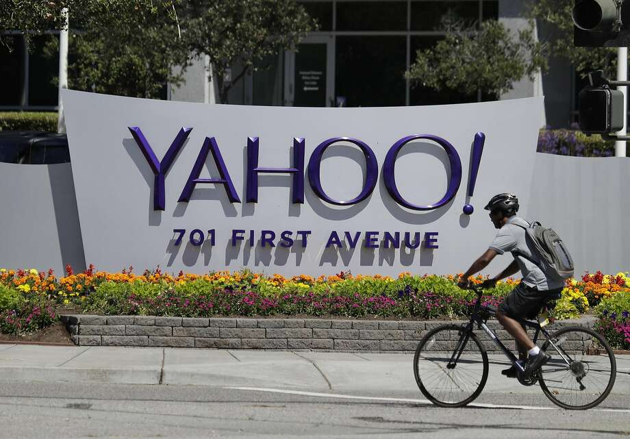 A cyclist rides in front of the Yahoo sign at the company's headquarters in Sunnyvale. Yahoo, like Google, is working on an end-to-end encryption system for email but has not rolled it out yet. Photo: Marcio Jose Sanchez, Associated Press