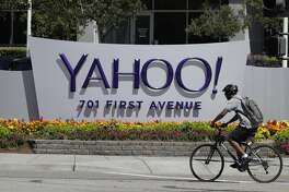 A cyclist rides in front of the Yahoo sign at the company's headquarters Tuesday, July 19, 2016, in Sunnyvale, Calif. (AP Photo/Marcio Jose Sanchez)