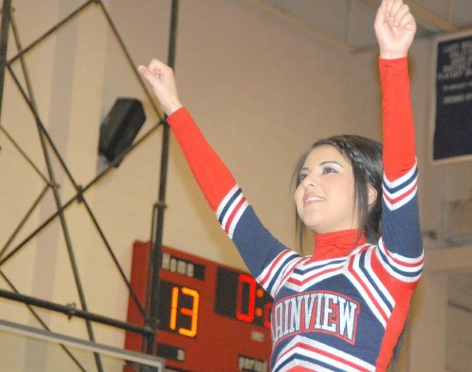 Plainview High varsity cheerleader Erica Espinosa leads a cheer from atop a human tower during a recent Plainview High Lady Bullodgs game in the PHS Dog House. The Lady Dogs will be playing for keeps Friday night when they open district play against rival Frenship High School in Wolfforth. The Lady Tigers will host the games in their Tiger Pit in Wolfforth with the varsity girls playing at 6 p.m. The freshmen and junior varsity teams both play at 4:30 p.m. The Bulldogs host Dumas in Plainview on Friday in their final non-district game. Photo: Doug McDonough/Plainview Herald