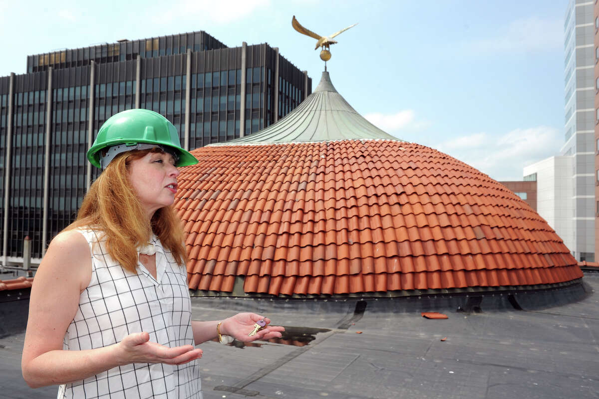 Kathy Maher, exective director of the Barnum Museum, speaks on the museum's roof near the iconic dome in Bridgeport. The dome reveived severe structural damage in the tornado that struck the city in 2010.