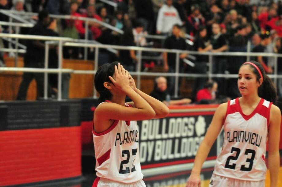 The Plainview Lady Bulldogs' Michelle Portillo (left) reacts as Karli Wheeler looks on after Portillo had her game-winning shot attempt blocked during the Lady Dogs' District 3-4A game against the Canyon Lady Eagles on Friday in the DogHouse. Photo: Ryan Thurman/Plainview Herald