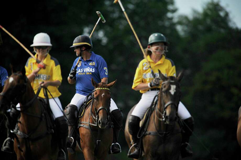 Will Orthwein, center, with Las Vinas rides out with players from Bloomfield at the start of the Veuve Clicquot Challenge Tournament Finals at the Saratoga Polo grounds on Sunday, July 24, 2016, in Greenfield Center, N.Y.  The next tournament is July 29th at 5:30pm.  (Paul Buckowski / Times Union) Photo: PAUL BUCKOWSKI / 20037385A