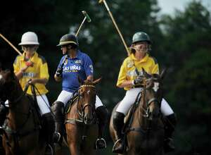 Will Orthwein, center, with Las Vinas rides out with players from Bloomfield at the start of the Veuve Clicquot Challenge Tournament Finals at the Saratoga Polo grounds on Sunday, July 24, 2016, in Greenfield Center, N.Y.  The next tournament is July 29th at 5:30pm.  (Paul Buckowski / Times Union)