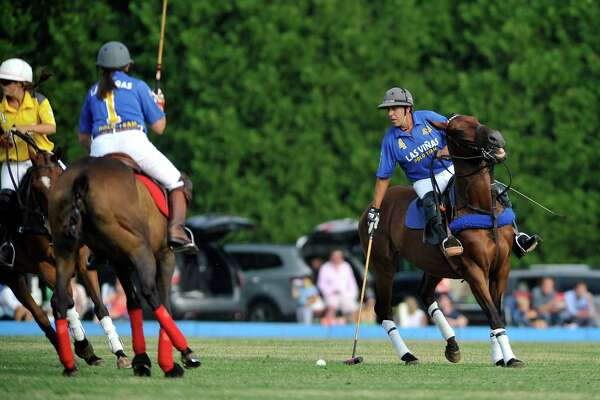 Cuko Escapite with Las Vinas hits the ball  during the Veuve Clicquot Challenge Tournament Finals at the Saratoga Polo grounds on Sunday, July 24, 2016, in Greenfield Center, N.Y.  The next tournament is July 29th at 5:30pm.  (Paul Buckowski / Times Union)