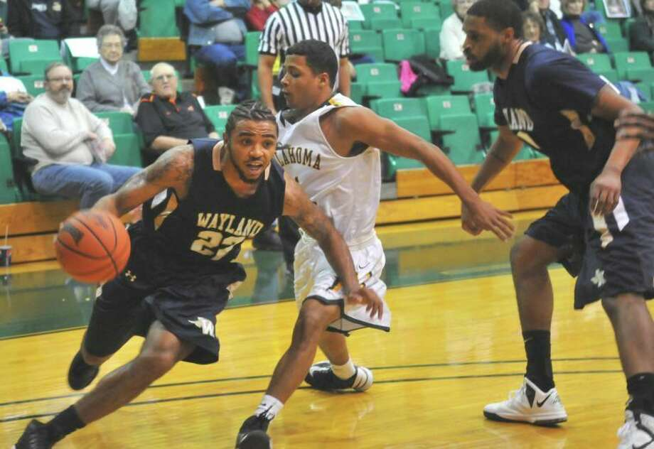 "Reggie Fondren, a senior from Memphis, Tenn., drives past a defender in the Pioneers' latest game against Oklahoma Baptist. The Pioneers return home on Thursday to take on Mid-America Christian at 8 p.m. in Hutcherson Center."" Photo: Richard Porter/Wayland Baptist University"