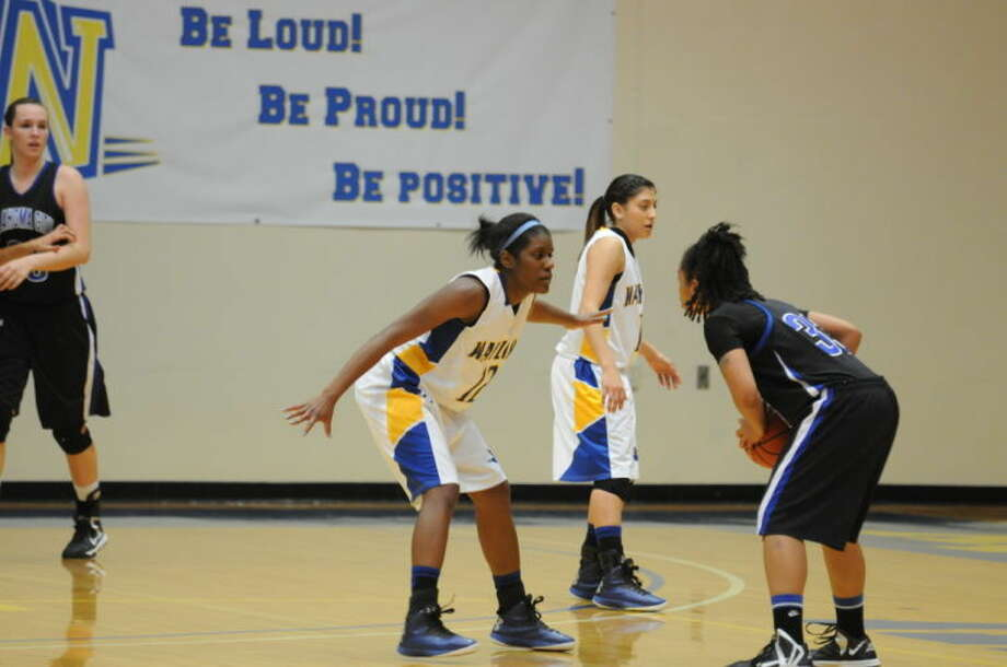 Wayland's Christie Mooney (left) and Laura Castillo led the team in scoring with 18 and 16 points, respectively, in the Flying Queens' tough loss to Oklahoma City University on Saturday afternoon. Photo: Wayland Baptist University Photo