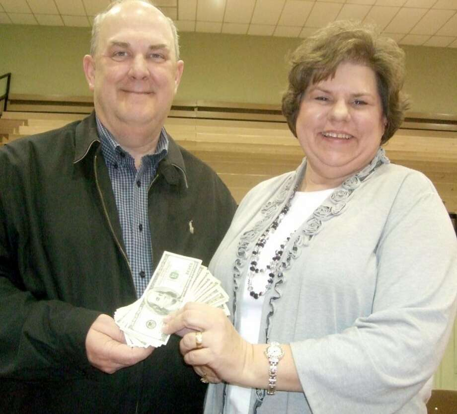Jimmy and Karen Rogers went home with $2,000 from the annual Hale County Stock Show Supper held Thursday night at the Ollie Liner Center. The Rogers' ticket and one held by Joe and Wanda Leach were the final two in a drawing that saw every 10th ticket holder win $100. The Leaches went away with $1,000.