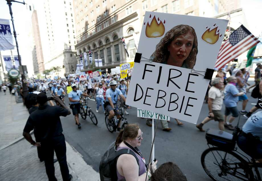 A supporters of Sen. Bernie Sanders, I-Vt., holds up a sign call calling for Debbie Wasserman Schultz, chairwoman of the Democratic National Committee to be fired, Sunday, July 24, 2016, in Philadelphia. The Democratic National Convention starts Monday. (AP Photo/Alex Brandon) Photo: Alex Brandon/AP