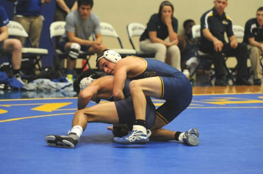 Wayland wrestler Justin Williamson (right) went undefeated at the Lone Star Duals in Dallas on Saturday, winning all four of his matches. Photo: Wayland Baptist University Photo