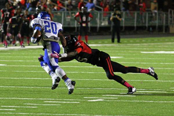 Memorial's Kary Vincent, 5, brings down a Ranger runner in the game between the Memorial Titans and the Baytown Sterling Rangers at Port Arthur's Memorial Stadium, Friday, October 10, 2014.  Photo provided by Kyle Ezell
