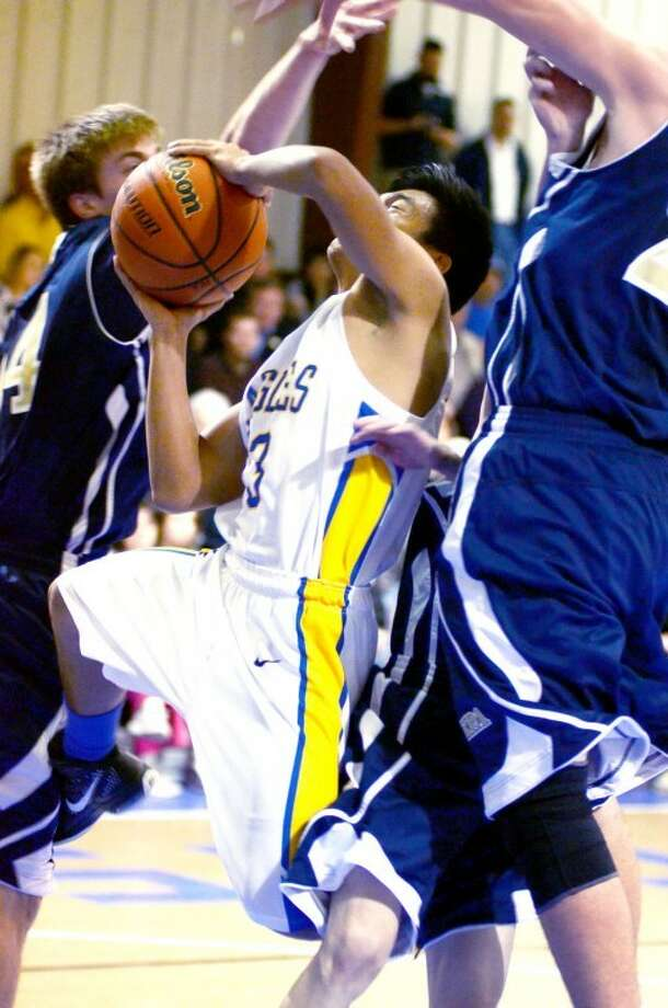 Courtesy Photo by Cathy LandtroopPlainview Christian Arjay Castro puts up a shot in traffic.