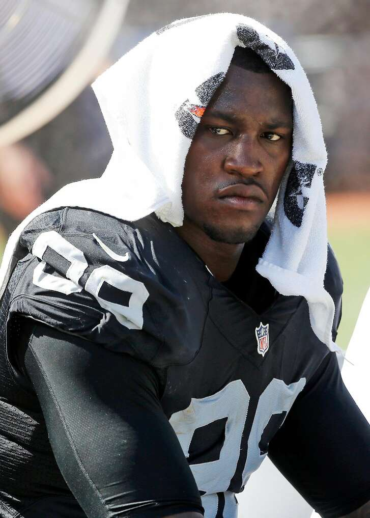 FILE - In this Sept. 20, 2015, file photo, Oakland Raiders defensive end Aldon Smith (99) cools off during an NFL football game against the Baltimore Ravens in Oakland , Calif. Every year, there are blue chippers carrying red flags. This season, the marketplace has Richie Incognito, Greg Hardy, Aldon Smith, Adam Jones, Andre Smith, Nick Fairley, Percy Harvin and Junior Galette. Lots of talent there, but plenty of locker room and off-field concerns, too. (AP Photo/Tony Avelar, File)