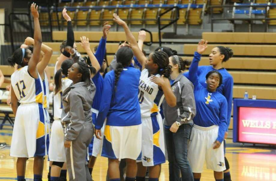 The Flying Queens celebrate after a recent win at Wayland's Hutcherson Center. Wayland Baptist defeated USAO 74-59 Thursday. Photo: Wayland Baptist University Photo
