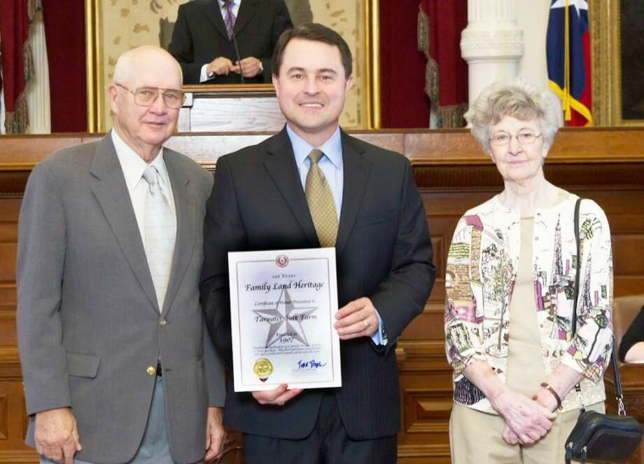 Courtesy photo by Alex Labry PhotographyTexas Agriculture Commissioner Todd Staples (center) recently recognizedJames and Betty Belk of the Tarwater-Belk Farm at the Family Land Heritage ceremony at the Capitol in Austin. Tarwater-Belk Farmin Hale County was honored for acceptance into the Family Land Heritage Program for 100 years of agricultural operation.Tarwater-Belk Farm has been in continuous agricultural production since1907 by the same family. To qualify for the Family Land Heritage Program, farm and ranchland must have been continuously owned and actively operated by the same family for at least a century. Land that has been rented to a non-family member does not qualify.