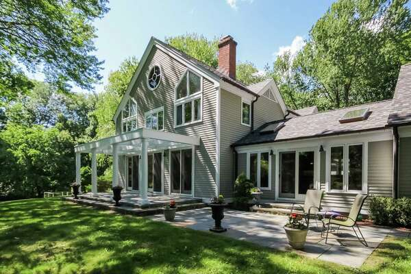 The green slate-colored contemporary colonial house at 41 Gay Bowers Road in the Greenfield Hill section of Fairfield, Conn. is on the market for $1,487,000.