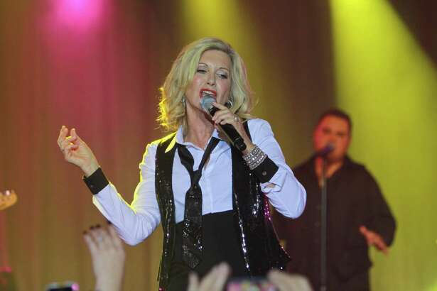 Olivia Newton-John, shown performing in 2012, arrives at Majestic Theatre for a concert on Nov. 6.