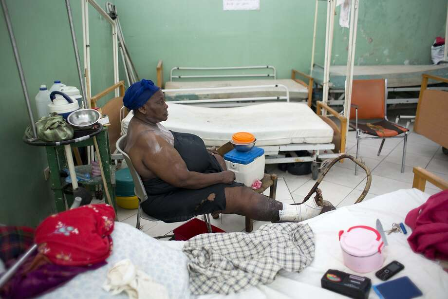 Patient Penina Pierre waits in a dermatology ward at the Hospital of the State University of Haiti. Photo: Dieu Nalio Chery, Associated Press