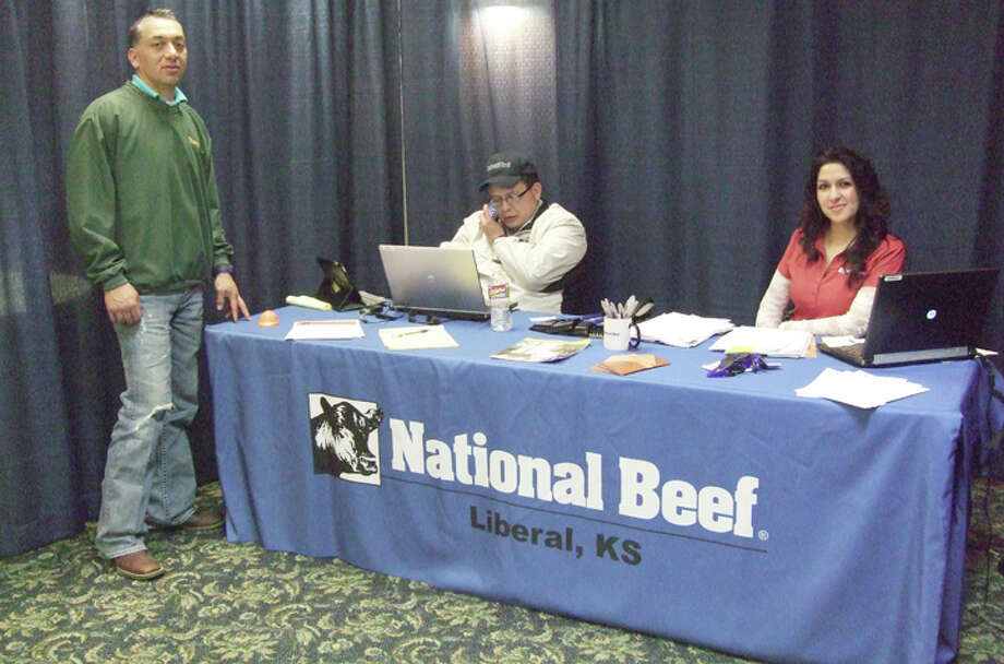 Cargill competitors are setting up booths at the Plainview Country Club to recruit laid-off workers. Seen in photo are representatives from the Liberal, Kan.-based National Beef. The job fair continues today and runs through Friday. Photo: Shanna Sissom / Plainview Herald