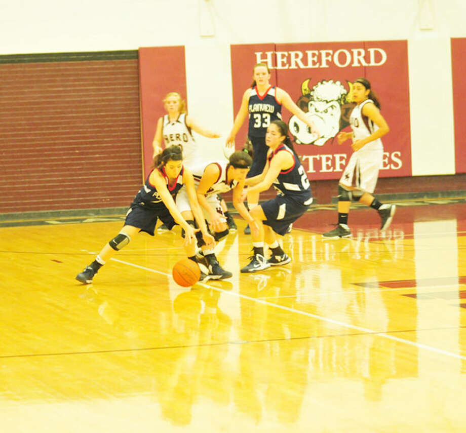 Lady Dog Shalee Bennett draws a steal during Tuesday's matchup in Hereford. Photo:  Homer Marquez/Plainview Herald