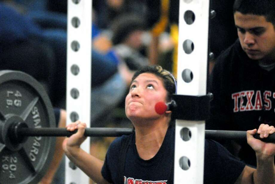Plainview High School senior Stacey Riojas concentrates as she completes a squat during Saturday's power lifting meet at Coronado Junior High.