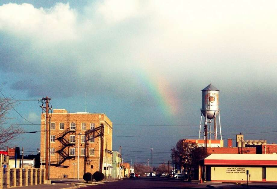 "Gordon Zeigler/Plainview HeraldA combination of moist air amid clouds east of Plainview about 4:30 p.m. Monday, and bright afternoon sun from the west, combined to create a brilliant rainbow over downtown Plainview. Here the shaft points downward toward a water tower in downtown, which was repainted in 1992 during filming of the Paramount movie ""Leap of Faith."" The film starred Steve Martin and Debra Winger and was set in mythical Rustwater, Kan."